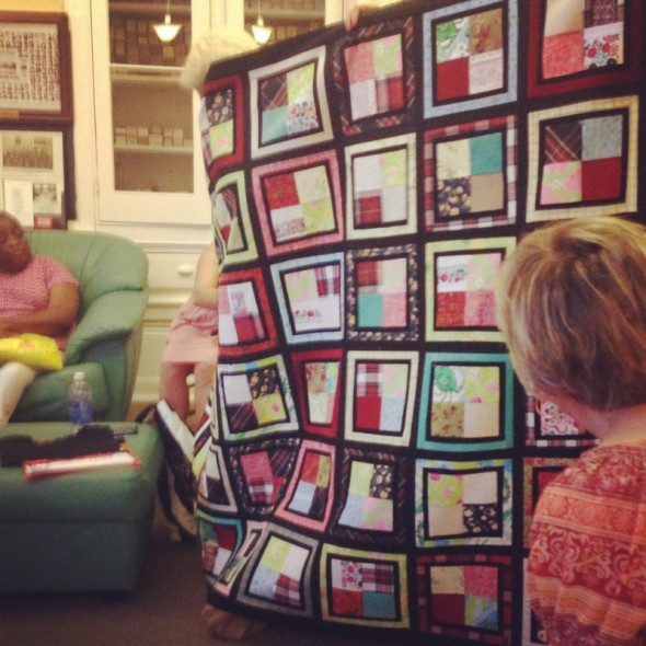 Diane's commission quilt out of childhood clothes. I'm obsessed.
